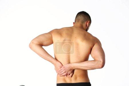 Foto de Joven sosteniendo su cuello con dolor. Concepto médico . - Imagen libre de derechos