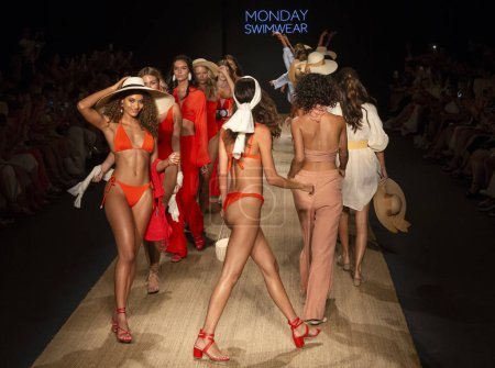 MIAMI BEACH, FL - JULY 13, 2018: Models walk the runway at the Monday Swimwear Collection during the Paraiso Fashion Fair at The Paraiso Tent