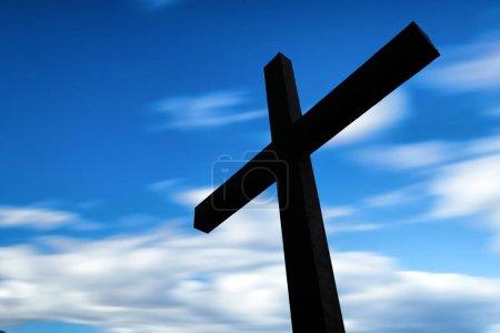 Photo pour Croix en silhouette avec un ciel coloré et nuage - image libre de droit