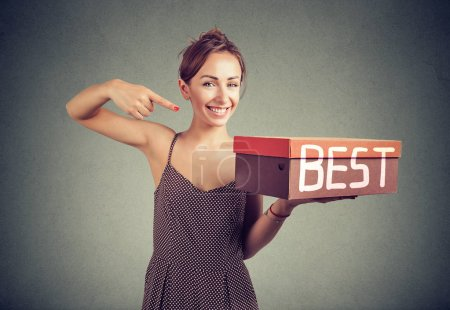 Smiling young saleswoman advertising best product...