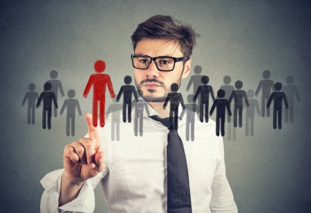 Photo for Business man making a choice for a new job opportunity from a crowd of people - Royalty Free Image