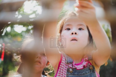 Photo for Girl kids playing with friends outdoor - Royalty Free Image