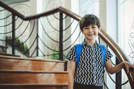Photo for Portrait cute boy standing on floor with school bag, happy smile with copy space - Royalty Free Image