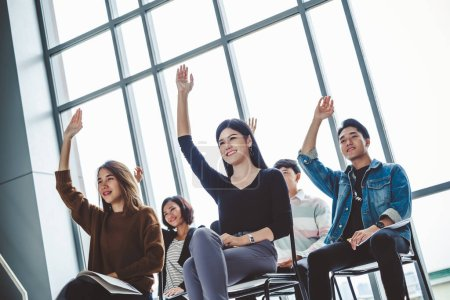 Photo for Group of business people raise hands up to agree with speaker in the meeting room seminar - Royalty Free Image