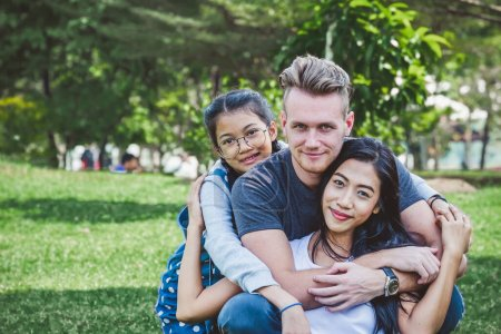 Photo for Diversity family portrait at green park, happy family concept - Royalty Free Image