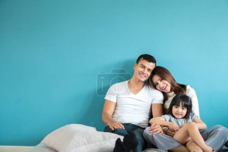 Photo for Portrait happy Asian family over blue background - Royalty Free Image