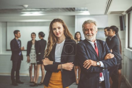 Photo pour Portrait business man and woman over group of business people working in office - image libre de droit