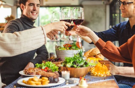 Photo for Group of young people celebrating Christmas party dinner with clinking glass of wine and selfie - Royalty Free Image