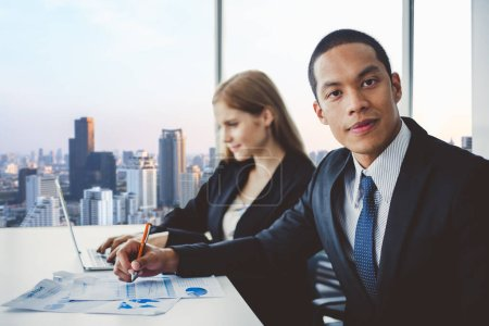 Photo for Business people discussing while meeting in office, working with laptop - Royalty Free Image