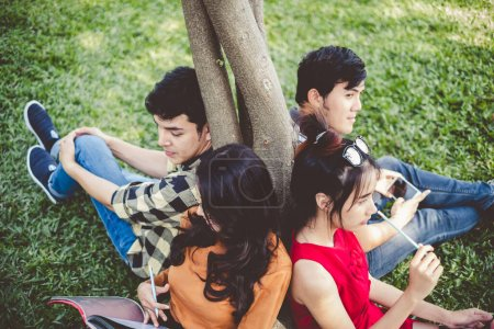 Photo for Asian young teen student sitting in park for studying and education concept - Royalty Free Image