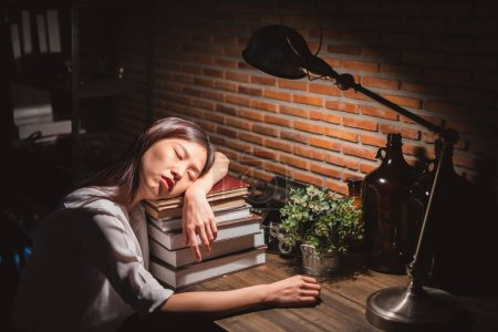 Photo pour Young Asian business woman working over time at night, work hard, tried, stress concept - image libre de droit