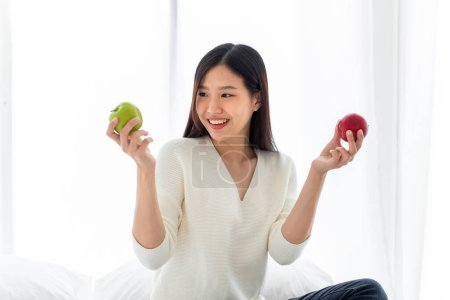 Photo for Asian woman holding red and green apples fruit for healthy eating concept - Royalty Free Image