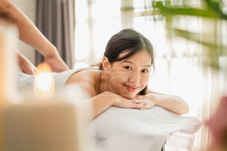 Photo for Young Asian beauty woman enjoying massage and spa - Royalty Free Image