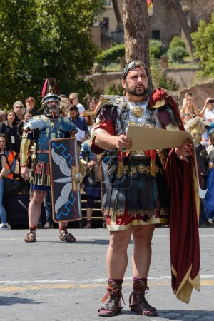 Rome, Italy - April 23, 2017:  the representation of the ancient romans in the Birthday of Rome, with centurions, soldiers, legions, senators, handmaidens, and virgins in Fori Imperiali street, Rome, Italy