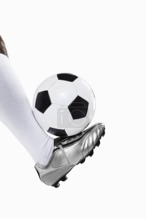 Photo for A soccer player balancing a ball - Royalty Free Image