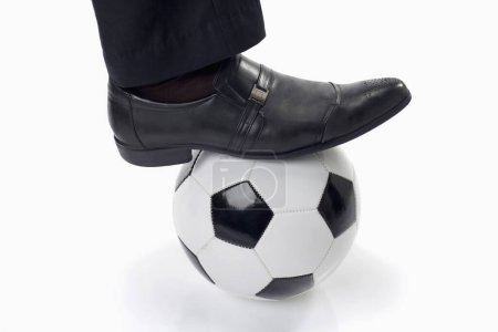 Photo for Soccer manager with a ball under his feet - Royalty Free Image