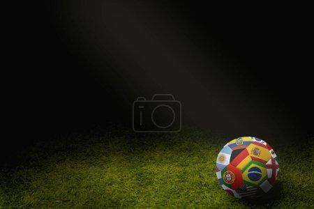 Photo pour Drapeaux du monde ballon de football sur un terrain de jeu - image libre de droit