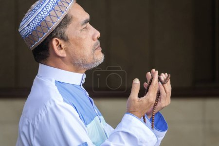 Photo for Middle age muslim man praying at mosque. - Royalty Free Image