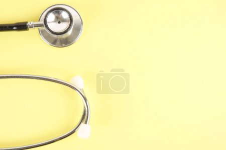 Photo for Medical Concept with stethoscope ,syringe  isolated on yellow background. Copy Space - Royalty Free Image