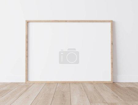 Photo pour Cadre horizontal en bois maquette sur parquet - image libre de droit