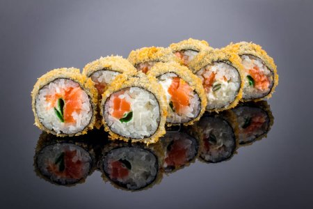 Photo for Hot roll with salmon tempura on black with reflection - Royalty Free Image