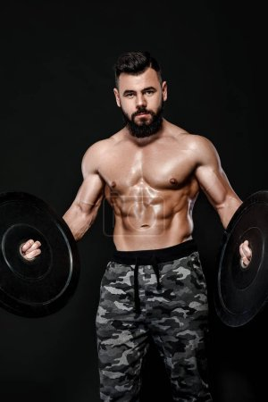 Photo for Athletic muscular man workout with heavy barbell plate weight - Royalty Free Image