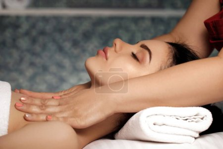 Photo for Anti-aging facial massage. Woman receiving massage from masseur at Spa salon. - Royalty Free Image