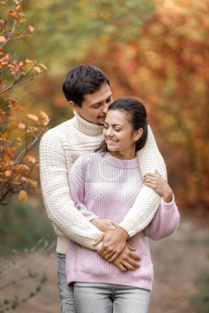 Photo for Couple in love hugging on beautiful autumn day in park. happy moments of life - Royalty Free Image