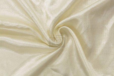 Photo pour Tissu de soie. Tissu brillant artificiel léger de couleur ivoire, fond, soie, satin - image libre de droit