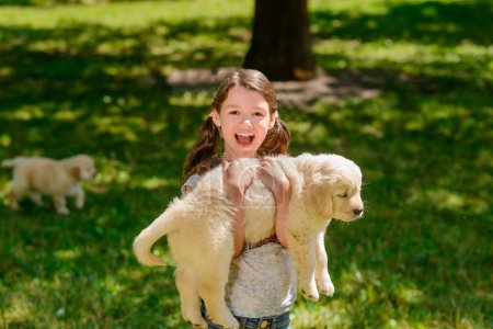 Girl carrying a puppy