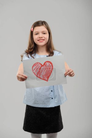 Girl showing a valentine card