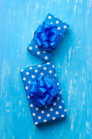 Polka dots gift wrapping paper, ribbons. Boxes put...