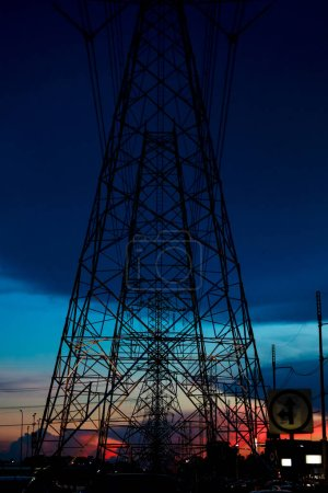 Photo for Electric power concept : high voltage tower and electric pole with twilight sky on background - Royalty Free Image