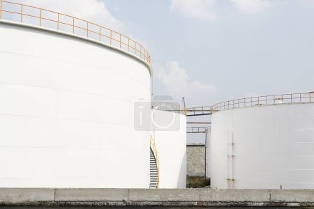 Photo for Huge oil storage tanks, At construction site of oil and gas industrial with the cloudy sky background - Royalty Free Image