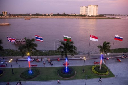 Cambodia, Phnom Penh, December 16, 2017: view of flags in a row on promenade at Phnom Penh