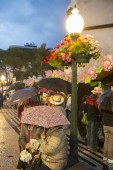 Rain at market street at the avenida Arriaga at the Festa da Flor or Spring Flower Festival in the city of Funchal on the Island of Madeira in the Atlantic Ocean of Portugal.  Madeira, Funchal, April, 2018