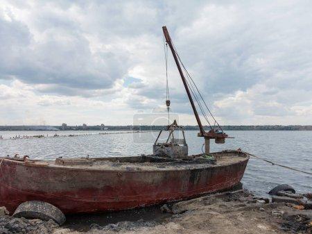 Old boat on a lake sunset. Kuyalnik estuary, Odessa, Ukrain