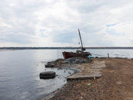 Old boat on a lake sunset. Kuyalnik estuary, Odessa, Ukraine