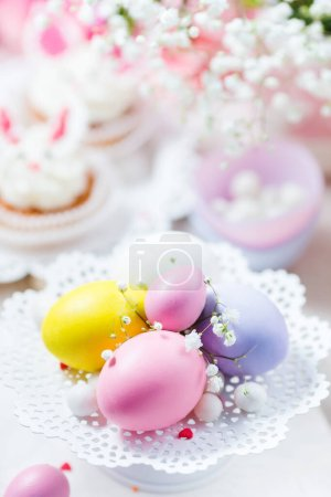 Photo for Easter eggs with decorations on table - Royalty Free Image