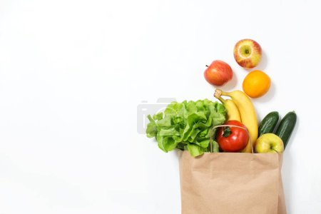 Photo for Fresh vegetables and fruits in paper bag on white background - Royalty Free Image