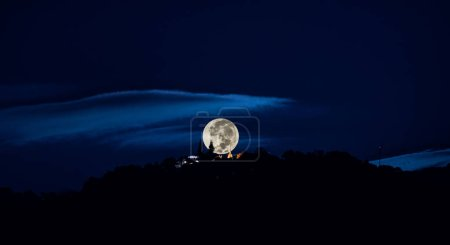 Photo for Silhouette shot image of big moon at Wat Phra That Doi Suthep temple ,Chiang mai,Thailand. - Royalty Free Image