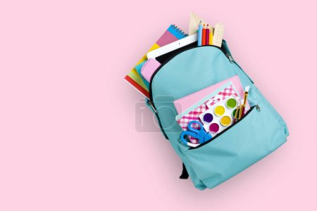 Photo for Full school backpack isolated on pink background - Royalty Free Image