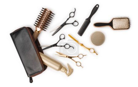 Photo for Essential hair dresser tools with leather bag on white background - Royalty Free Image
