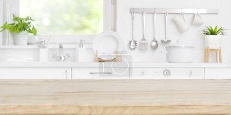 Photo for Wooden table top on blur kitchen room and window background - Royalty Free Image