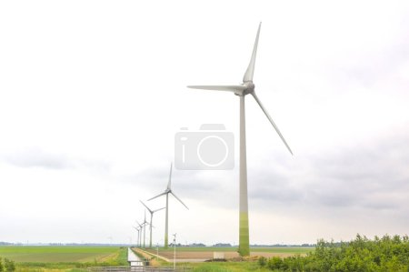 Photo for Wind energy farm in a field - Royalty Free Image