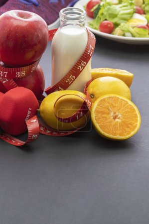 Photo for Healthy eating concept. measuring tape, fresh fruits and vegetables  on the table - Royalty Free Image