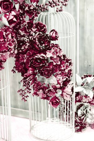 Photo for Decoration of red flowers and white cages - Royalty Free Image