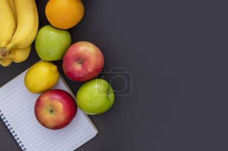 Photo for Fresh fruits and blank notebook, diet concept - Royalty Free Image