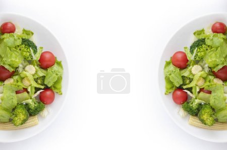 Photo for Salad on plates. isolated on white - Royalty Free Image
