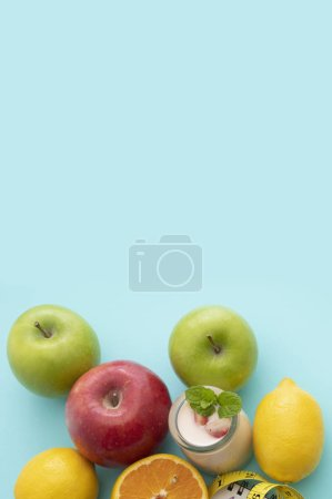 Photo for Fresh apples on a blue background - Royalty Free Image